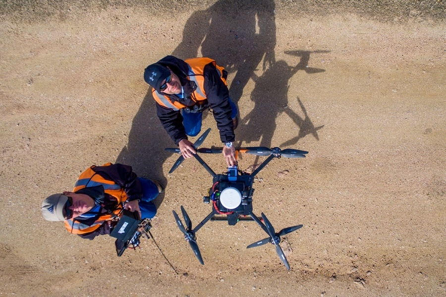 Pilots with McCord Engineering prepare their aircraft and its LiDAR sensors for a flight along Pedernales EC power lines.