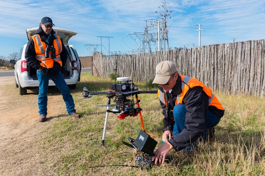 Pilots with Texas Drone Professionals prepare their aircraft and its LiDAR sensors for a flight along Pedernales EC power lines.