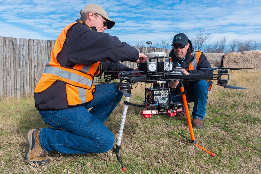 Workers prep a $200,000 power line inspection drone in the Hill Country.